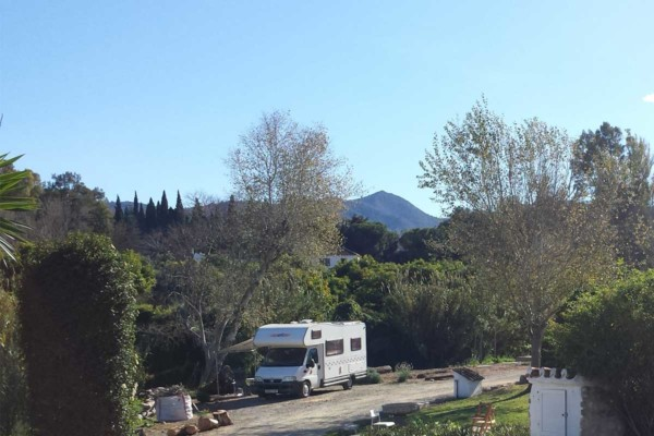 Photograph of a motorhome in a mountain setting