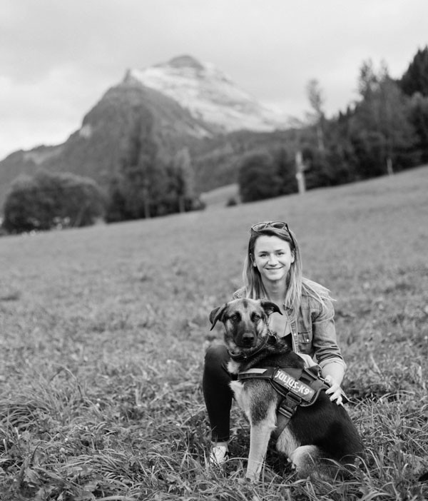 Black and white photo of Holly Lewis and dog in the mountains