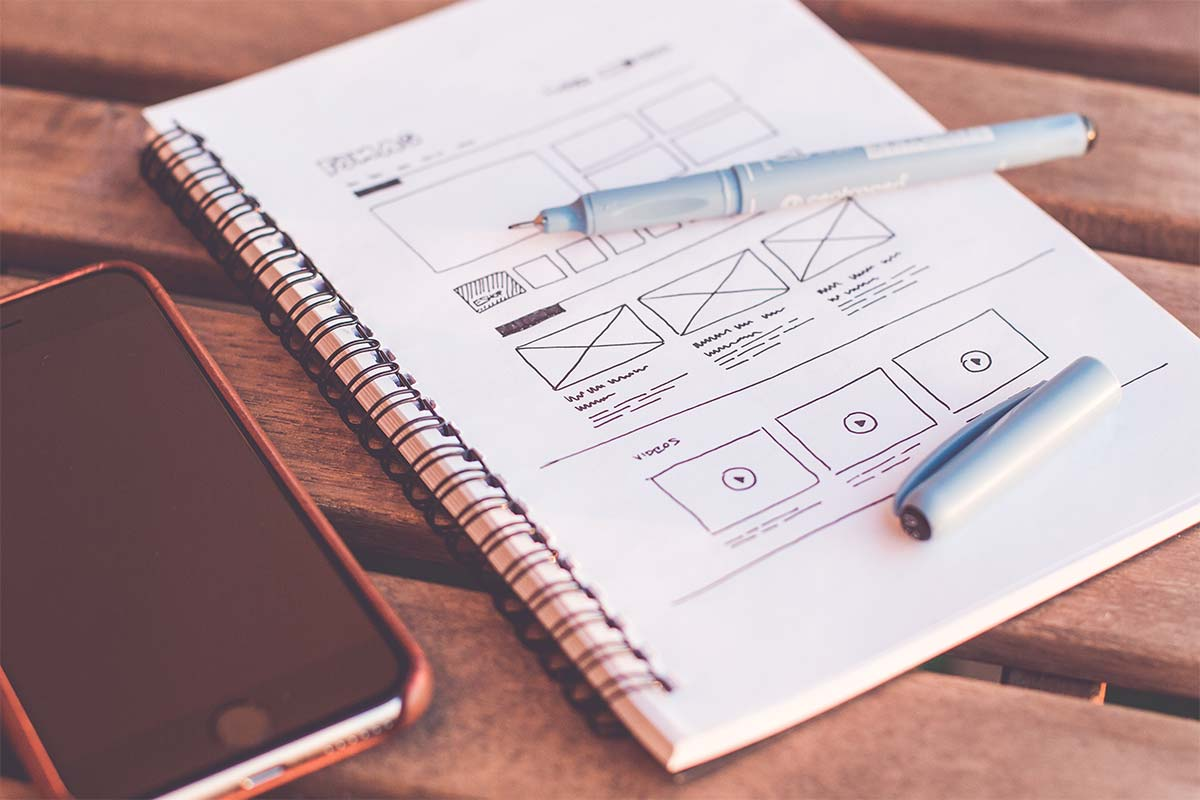 A notepad with a drawing of a website wireframe