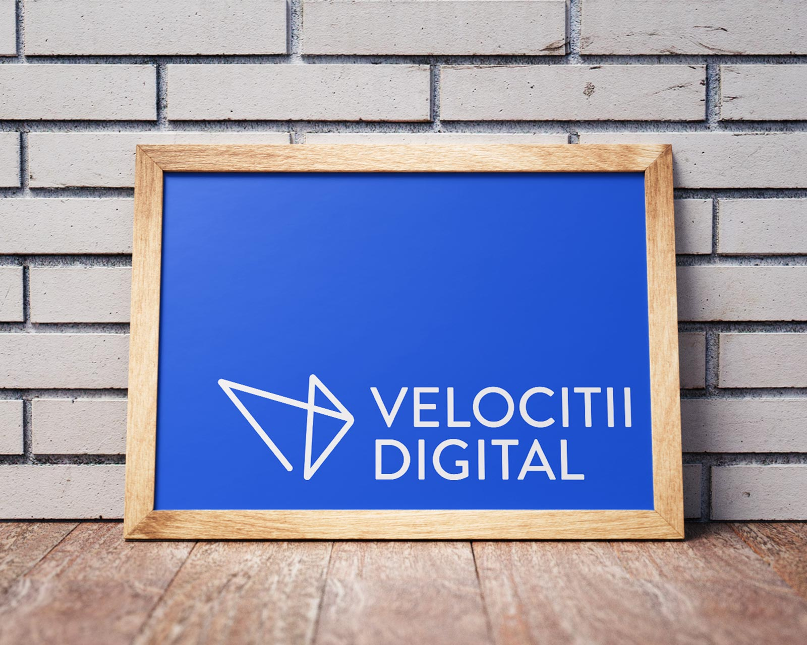 Velocitii Digital logo on a poster in front of a brick wall